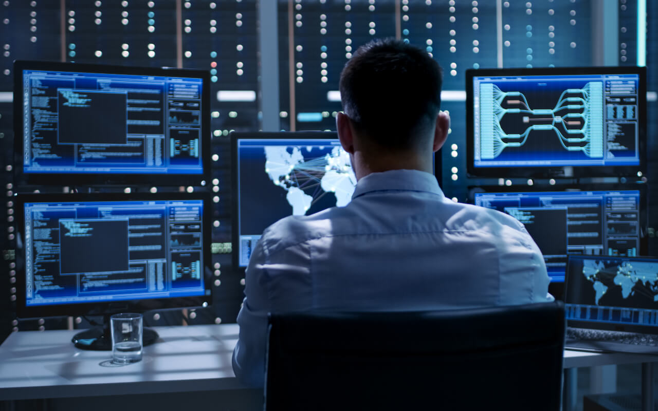 man sitting in control room